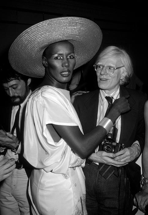 "Abbildung von Andy Warhol with Grace Jones. ""Grease"".Premiere Party. Studio 54. 1978"